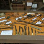 Photo of a display filled with an assortment of knives and tools